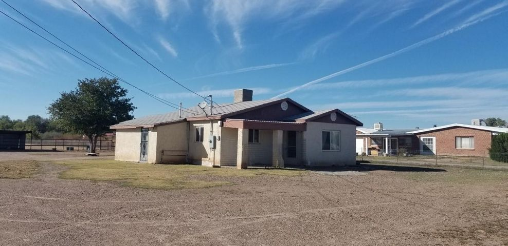 COMMERCIAL POTENTIAL!!  Think Creative.. P&Z conditional use permit.. OR.. Re-zoning.. With 120 Feet of Highway Frontage,  This is a perfect property  to Capture the high Traffic in Los Chavez traveling on NM Highway 314!!  ** PLUS**  ADDITIONAL AVAILABLE (2) 1 Acre lots to the WEST TOTALING 3.7 Acres Total Available..  see MLS for additional land listings.Currently, this is a quaint 2/3 bed 1 bath home with 1 car garage with plenty of room for the Animals, with pens and pasture.. Gated entry for Privacy. Come live out your dreams here..