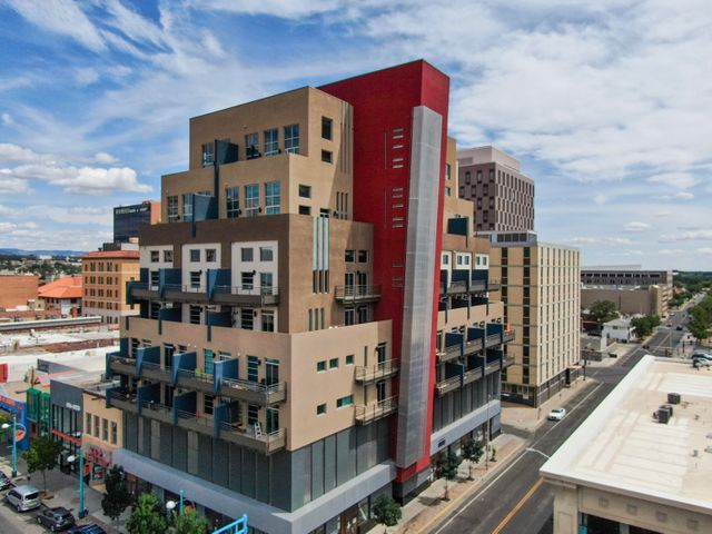 Incredible opportunity to own a luxury studio in Downtown Albuquerque. This modern building finished in 2015, features amenities not found in most downtown buildings. Full kitchen with stainless steel appliances, high end cabinetry, clearly more than any typical studio.Facing West, this condo offers great views towards Old Town, the Bosque, Rio Grande River and beyond. Minutes walking distance to the popular Downtown Farmer's market every Saturday from Spring to Fall and many other spots for dining, shopping or for entertainment.With 2 recent sales in the building in excess of $200/sqft, this unit @$183/sqft is an awesome opportunity whether for full time living or just as a pied-a-terre.1 secured parking spot.Due to the building's exclusiveness, short term rentals are not allowed.