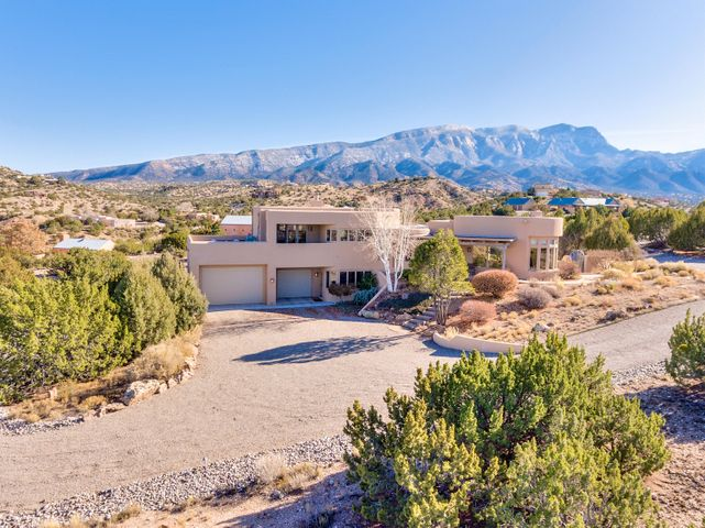 You will love your custom home on this private lot on 2 acres. Upon arrival, notice the Custom front wood door under a covered entry.  The first office off to your left has great views to inspire.  The living space is purposefully located in the area for the best views of the mountains and city lights at night.  Many spectacular custom features include: Vigas, flagstone flooring,  lighting package, decorative hardware,  thermal efficient windows, iron handrails, custom painted mural at stairs,  2 master suites, and many more to see.  Updates include 2 new microwaves, paint, radiant heat system, & furnace. The storage and flow of this home are just a couple more amenities to see in person. Just 2 miles from I-25, arrive off the main road to a private drive with only 3 homes on a cul-de-sac.