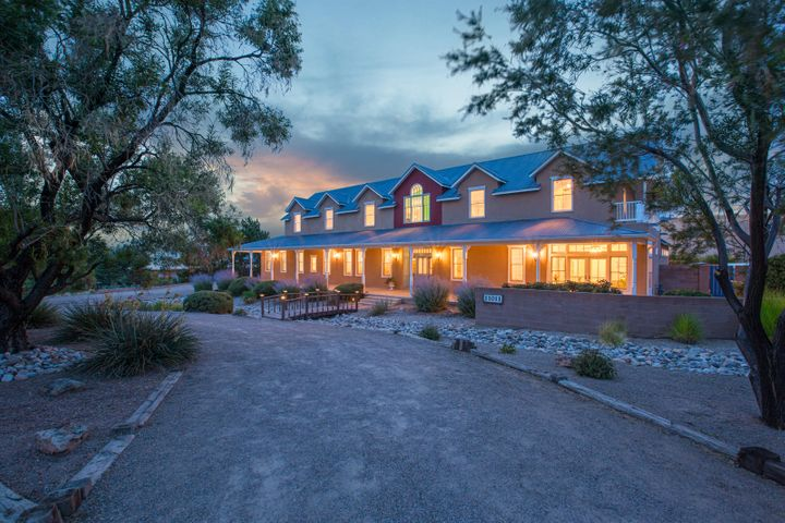 3D tour this grand Northern NM style custom home. This unique 5/6 bedroom is on a quiet, dead-end street in NAA. Live, love and entertain with this exceptional floor plan, complete with 2 living areas-2 master suites, one on the main level. Master bedroom balcony. Bright and open family room is attached to the kitchen with fireplace, expansive island, custom built-in entertainment cabinet and access to the backyard and protected covered patios. Downstairs French kitchen features granite counter tops, gas cook-top, custom tile back-splashes and inviting hardwood floors with in-floor radiant heat. So many custom features in every room - see special features doc. Rare and unique find!Updates, upgrades and renovations throughout