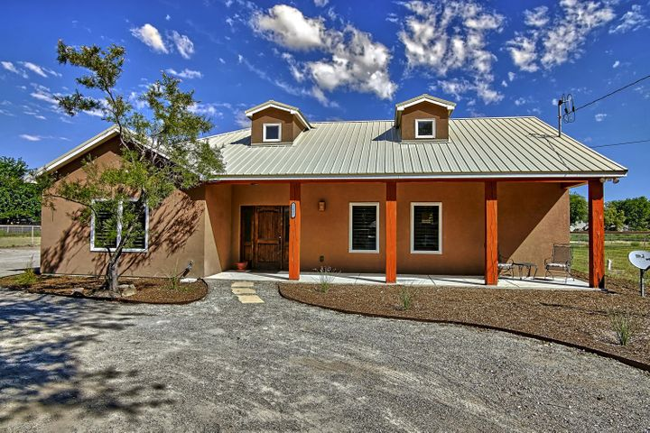 Absolutely stunning Northern NM custom home nestled in the South Valley on Highly Desirable 1 acre lot Ideal Horse Property near the River! Spacious GR boasts cathedral ceilings/relax by the FP w/Hand Hewn Mantle/Stone hearth & Faux stone surrounds! Open Flow of GR/DR/Kitchen! Granite slab counters/Huge SS fridge/freezer/Walk in pantry/Gorgeous Alder custom cabinetry! 3rd BR currently is office! Custom doors/Decorator paint/Newly refinished custom concrete floors & New carpet! Upgrades thruout! Private Owners suite is a true retreat w/Huge closet/Decorator Tile Bath w/Jet Tub! Utility w sink/dog wash area! Lovely covered patio to enjoy the beautiful greenery of the Bosque! Bring the horses, cows, includes 6 Stall Shed Row Barn+Tackroom/Hay storage/Cross fenced! Livestock ok