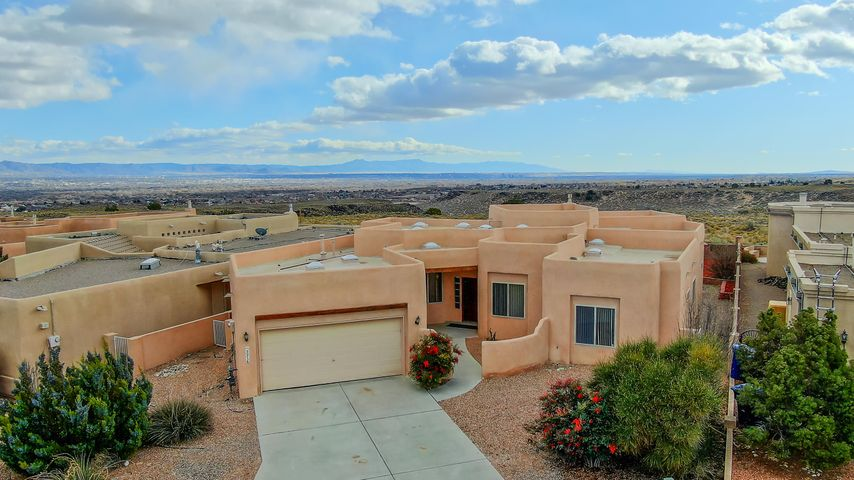 Views that remind us why we fell in love with ABQ !  New paint , new carpet , new granite countertops, new stucco , and new roof ! Additional upgrades have gone into the home to show pride in ownership .  Enjoy watching the balloons as send or watching 4th of July fireworks from the luxury of your back yard ! This property has limitless possibilities.....