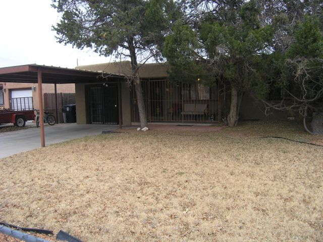 Your buyers will love this cozy home located within minutes of UNM and Uptown. The home features 3 possible bedrooms, a very sturdy carport and a large kitchen and large utility area. The backyard is good sized and features a steel covered patio area, large storage shed, and a dog run that would be ideal for gardening. The house features security wrought iron included an enclosed front patio area. There are possible hardwood floors under all the carpet, buyer and buyer's broker to verify.