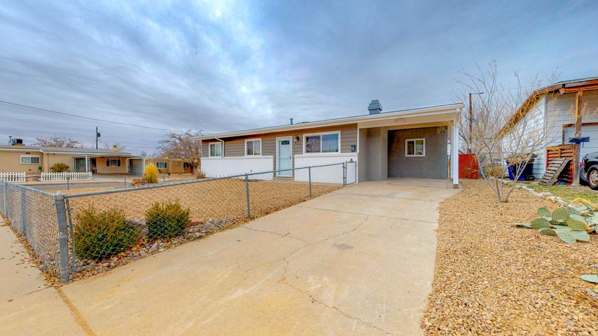 Great updated home in convenient NE location. Big beautiful backyard with high block/wood walls. New master cool AC unit. New roof last year! Newer cabinets and counter tops.  Newer laminate floors in the bedrooms. Partial Sandia Mountain views! This home won't last long!