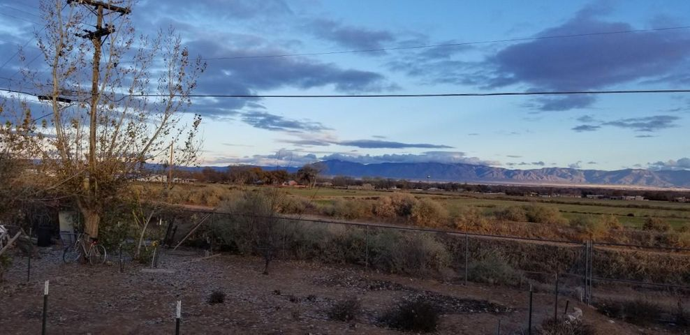 In the HEART of Los Lunas.. Minutes to the FREE~way... VIEWS.. VIEWS..VIEWS..3 Bedrooms,  2.25 Bath, 2 Car Garage.. This 2 Story sits on a LARGE .33 Acre Lot.. &.. Did we Mention Views?..