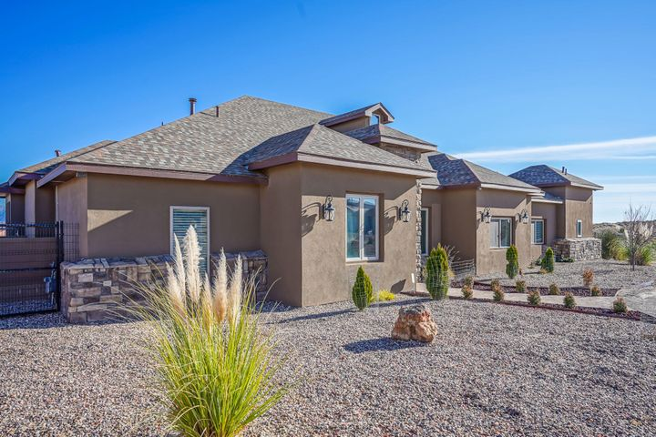 Fabulous Custom Home in the desirable Rio Rancho Estates boasts unobstructed views of the whole Sandia & Monzano Mtn Ranges and City Lights! This home offers all of the lastest & greatest amenities - Signature Gourmet Kitchen with open Living/Formal Dining/Breakfast Nook Areas.  Granite C-Tops throughout - Even the Outdoor Kitchen and Laundry Room feature Granite C-Tops!  Every Bedroom includes its own Bath as well. Home is Pet Friendly with Doggie-Door that leads to a concrete Dog Run. Extra separate Storage Area above the Garage, too! Property sits on 1.33 acres with Fenced & Landscaped Backyard.  Close to new Shops & Rust Hospital on Unser.  Must see to appreciate this quality built home!