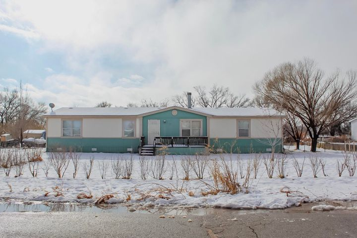 Come see this charming manufactured home nestled in the country, but close to all and access to I-25. This spacious home has 3 large bedrooms with walk-In closets. Master has huge bathroom with garden tub.  It has a open living plan and large kitchen with lots of storage and space for entertaining.  House comes partially furnished, and is move in ready. Back yard is crossed fenced with a dog yard off back deck.  Backyard has open meadow views and mature trees and landscaping. Space for RV or Boat parking  in back of driveway. Bring your Horses and enjoy the outdoors.  Come see this cozy home and make it yours!