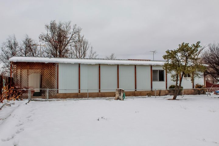 Come see this wonderful home on a corner lot. It is a manufactured home with a bonus room/office for extra storage. Has a built in outdoor brick BBQ, screened in porch, crossed fenced yard, storage shed, fenced garden area, mature trees and flowering shrubs. Metal roof, 2018 Evaporative cooling unit, Covered Carport, easy  access to 25 fwy. Bright and open corner lot has room to enjoy the outdoors and landscaping. Come see this today and make it yours!
