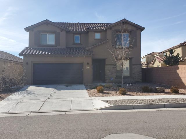 Wow!! MODERN Home has 2 MASTERS. Owner's SUITE down stairs w a Full SPA bathroom & walk in closet & upstairs is a IN- Law suite. The home has an ENTRY Den, a FULL living area open to the kitchen & a LOFT. So 4 bedrooms, 3 lIVING Areas and 4 BATHROOMS, 3 FULL and 1/2 bath for guests. Garage has a WORK area PLUS 2 car.Laundry upstairs. Button for INSTANT hot water. Tank-LESS water heater & REFRIGERATED Air. This home has stunning LARGE windows that makes this home so beautiful. SOARING ceilings & windows. The way they planned these windows you can see the beautiful SKY. Open kitchen W LARGE Granite  Counter w PLENTY of sitting area. OPEN to the Main Living Area, FORMAL Dining & a LOFT. Floor plan works for 2 FAMILIES sharing living space. Must see before its gone bcuz 2 Masters is RARE!!