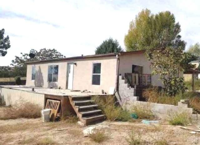 Cozy manufactured home on a large lot. Property features 3 bedrooms, 2 baths, alarge open kitchen and wood floors. The property is in need of repairs.