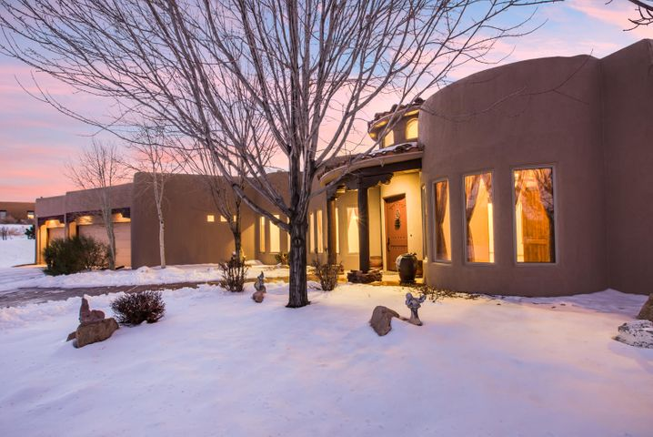 Custom single story in beautiful gated community of Nature Pointe just 15 minutes from Albuquerque.  Beautiful mountain views. Quality details throughout including custom entry tile mosaic, beamed viga & tongue & groove ceilings & corbels. Open design centered around great room & kitchen with raised ceilings, kiva style fireplace & large Anderson windows overlooking rear portal. Chef's kitchen w/ 6 burner Wolf range w/ double oven, sub-zero refrigerator, granite counters, pantry, island, vegetable sink, bar & skylight. Flexible floor plan includes family/game room, craft/mud room & Theater Room + 4 bedrooms.  , Refrig air, Cent. Vac, Alarm, Radiant Ht, R-57. Oversized Garage.  At the end of a cul-de-sac walking distance to amazing clubhouse w/ gym, indoor pool, tennis & basketball courts.