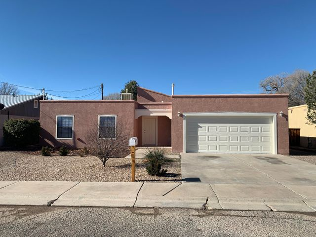 Come see this FULLY remodeled home with brand new flooring, hot water heater, furnace, refinished cabinets, toilets, sinks, tubs, paint  etc.  MOVE IN READY.  Close to shopping, churches and schools.  Easy commute to ABQ. You dont want to miss out on this one.