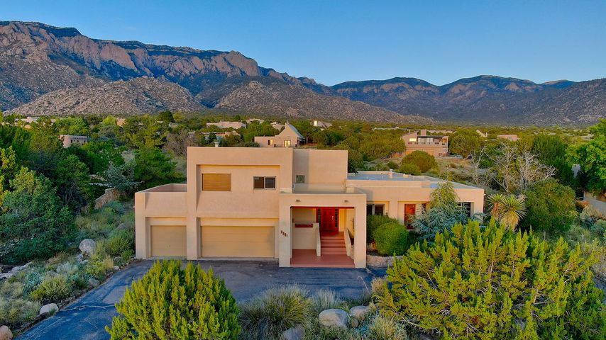 SW contemporary custom home with crisp, contemporary lines / elevation and exceptional mountain to city vistas. Premium +/- .79 acre view lot with outstanding east/west orientation for full natural light and views. Ground level main living plus upstairs exceptional Great Room with wet bar, Kiva fireplace and outdoor balloon deck for some of the best city views possible. Multiple living and dining areas, impressive gallery-like entry, great separation of master suite, large bedrooms, chef's kitchen with granite and upscale stainless steel appliances and much more. Outstanding outdoor living with courtyard privacy with relaxing custom waterfall/pond. A warm, inviting home with charming Santa Fe style interior appointments. Just blocks to the National Forest. Forever Views!!