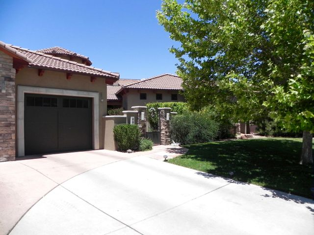 Parade of Homes Gold Award! Price is based on recent appraisal!  Soft Tuscan Ext Elev. w Open, View Oriented Floor Plan. Outdoor Space is part of the Living Area thru 12' Vista Wall Doors.Veranda (see Sunroom) Opens to GR & has full Wolf Outdoor Kit, 2 Way woodburn FP, Screened Portals w/ Mt & City Views, Heated Pool, Water Feature & Spa. Loaded w/ Amenities like Wolf Cooking, Sep Sub-0 Ref & Frzr Travertine & Wood Flrs,Tons o' Built in Cabs. Pella Win&Doors, Audio, Surround Sound,Vac. .26 Acre Lot!!