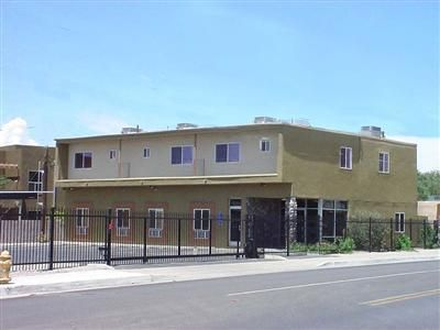 Great Location Near UNM & Downtown. Granite Countertops, Stainless Appliances, Travertine Marble & Berber Flrs, Skylights, Walk-In Closet, Maple Cabinets, Built-In Desk Area, Gated Building, Common Area: Gym, TV Washer/Dryers, BBQ, Individual Unit Storage