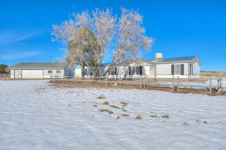 Beautiful manufactured home on 5 fully fenced acres of land. This home is over 2,200sqft with 3 bedrooms, 2 bonus rooms,3 bathrooms, and 2 living areas! 2x6 construction all tape and texture. Located only a few minutes from interstate 40, this home offers easy commute and accessibility to local shopping centers. Brand new remodeled home, completely refurbished and a new updated kitchen. This home also has a large detached garage!