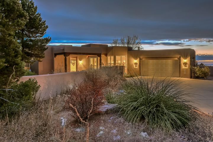 Stunning one story home on a beautiful lot in the Pinon Point subdivision of Hight Desert.  You will fall in love with the open floor plan that includes a master suite with his and her closets, a study/bedroom and 2 additional bedrooms on the opposite side of the house.  The kitchen features a gas stove and double ovens and opens to the the living area and the dining room.  The stunning cathedral ceiling  with wood vigas perfectly accents the living room.  This is a hard to find one owner home that has been loved and cared for.  Handle with ease the constantly changing New Mexico weather with radiant heat and refrigerated air.  Don't miss this gem in a superb location.  It won't last long.