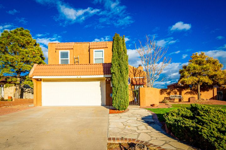 Come check out this absolutely beautiful home.  Perfect for family gatherings with a gated pool area and large kitchen. The master bedroom has a deck/balcony with views of the mountains.  Front yard has putting area for the golfer in the family