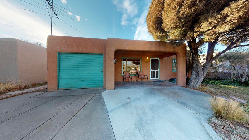 Incredible home for rental or family! Just blocks from UNM Medical and Law schools.  Unique layout allows for 2 separate homes.  Lovely hardwood flooring, ample eat in  kitchen, and 3 bedrooms in the main area. The striking addition provides a tree top master bedroom with Jacuzzi style tub and spacious views all around.   Abundant light and beauty throughout this sweet home.  Serene fish pond in back, pergola and fruit trees.  Small storage in area that used to be garage.  Includes all appliances and several goldfish!