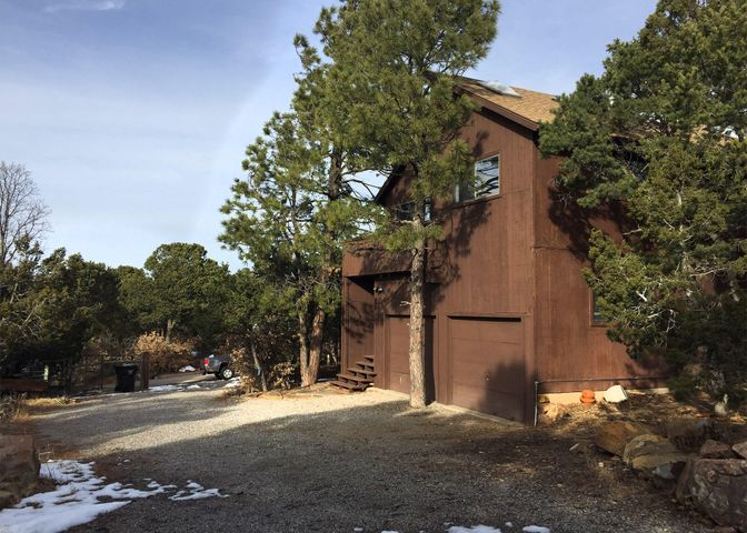 Mountain home nestled in the pines.  Great Cedar Crest location, just a 20 minute drive to ABQ.  Features stunning views of the Sandias, open feel with cathedral ceilings, fireplace/woodstove, remodeled master bath & updated kitchen.  Other features include, updated septic system, community & community water. Wonderful home, ready for a new owner!