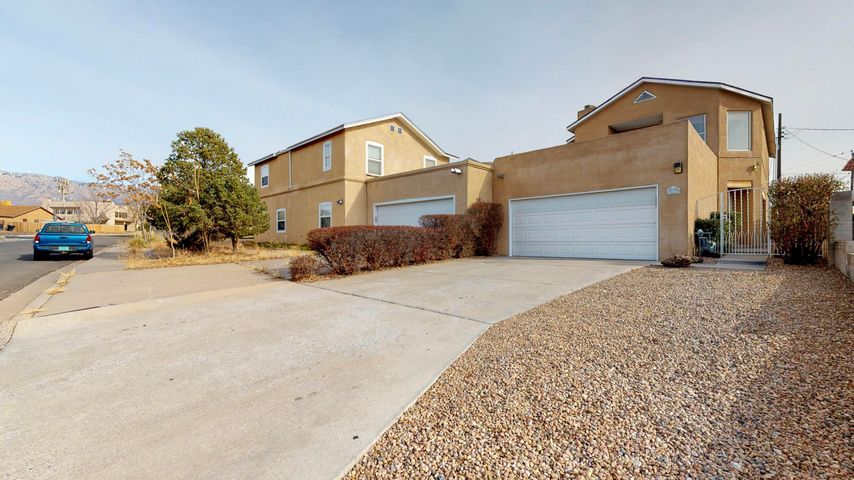 Great NE Heights Townhome. No HOA. Large 3 Bedroom, 3 Bathroom with 2 kiva fireplaces. Huge master bedroom with large walk-in closet and private view deck. Call today for your showing.