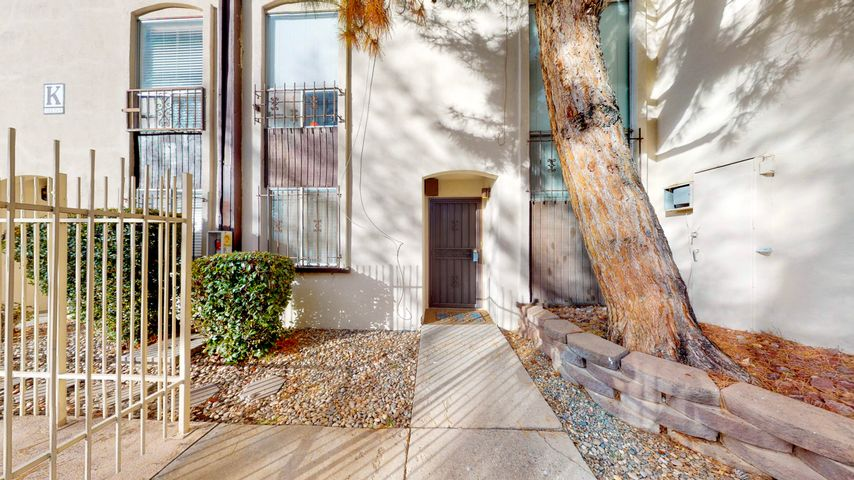 Charming Oasis in the desert,  2 story unit overlooking the pool. This unit is one of the largest in the complex. 2 bedroom, 2 1/2 bathrooms. Carport with assigned locked storage. Fenced patio perfect to relax, clubhouse, heated indoor pool, hot tub, sauna, exercise room, laundry room. HOA pays all utilities, all taxes, all common areas, exterior on the building.  Washer and dryer included ''as is''.  Beautiful laminate floors on the lower level with a wood burning fireplace. Walking distance and centrally located to popular restaurants, Trader Joe's, Winrock and Uptown malls. Come see this Condo Today!