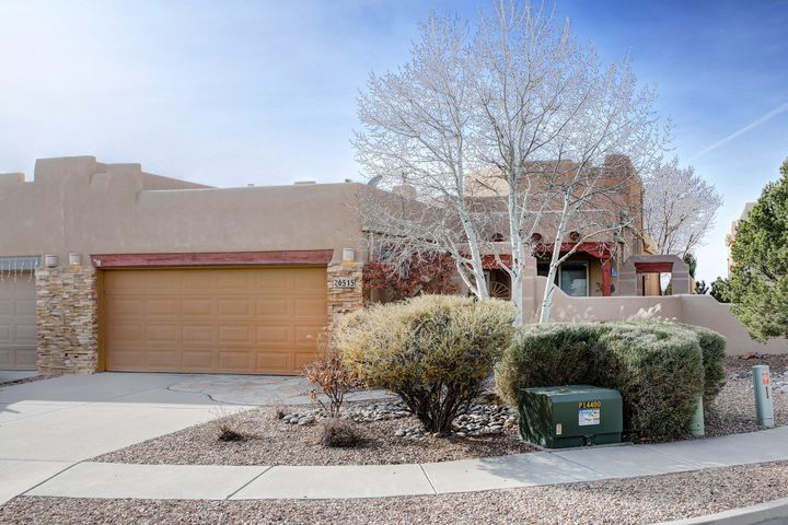 It's not often that a single level home under 2000 square feet comes available in High Desert, and this rare jewel on a cul-de-sac will not disappoint. Soaring ceilings with exposed viga beams and a ton of light, two enclosed landscaped patios, and a floorplan with room for everything you need. This lovely pueblo style townhome is ready to be yours. From the generous two car garage, to the laundry room with extra pantry storage, large kitchen with barstool seating at the island, to the beautiful sunny dining room open to the living room and its kiva style fireplace, this lovely home will have you at hello! The master bedroom at the end of the hall very large, and has a door out to the covered back patio for morning coffee. Truly, everything you need is here and has been lovingly cared for.