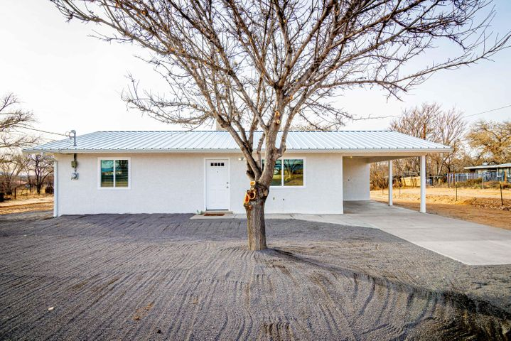 Fantastic home sitting on 3/4 acre! Come see all this home has to offer. New paint, carpet, appliances and so much more! No neighboring homes behind which allows for perfect views of the neighboring lot and bosque. New septic and a BONUS 11X6  attached and finished storage room. Perfect for an oversized pantry or garden tools, with access to the carport and back yard.  This is a must-see home.