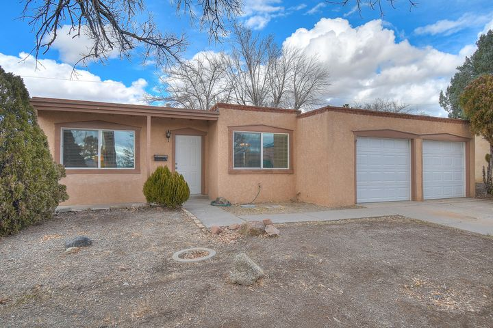 Stop by today to check out this charming 3 bedroom, 2 bath home in the NE Heights! Whether you're inside cozying up next to the custom Kiva wood burning fireplace or outside on the patio, there is plenty of room to entertain! Brand new plank flooring throughout kitchen and main living areas. This home boasts character and is conveniently located with easy access to all that Albuquerque has to offer!