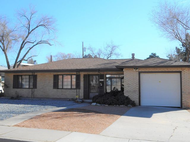 Check out this Brick Beauty favorably situated in heart of Albuquerque just minutes from restaurants, shopping and schools! BRAND NEW  ROOF (10/2019)  Warm laminate wood floors great you in the formal living room. Ceramic tiled Dining room with cove ceilings!Centrally located tiled kitchen with smooth top electric range, refrigerator, updated light fixtures, lots of cabinets and breakfast area!Second living area boasts laminate floors and a cozy brick fireplace with built in bookshelves! Separate service room with cabinets and wet sink. 5 bedrooms for the growing family! Newly redone Master bath shower! Updated guest bath! Covered patio in the rear is poised for summertime bar-b-ques in the private backyard.This NE Heights ''Brick Beauty'' is ready for a new family! See it today!