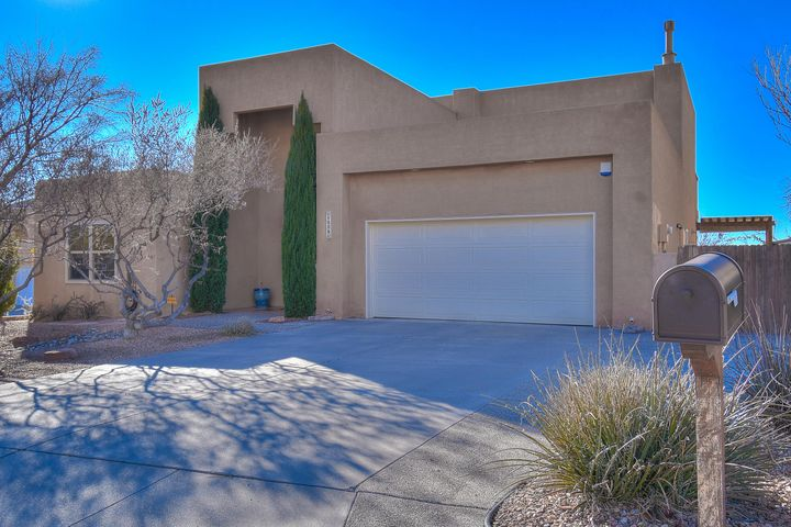 1st Showings at Open House 12/15, 1-3 pm. View floor plan in Photo's tab & 3D. Classic  turn-key 2 Story nestled in Sandia Mountain Foothills on private, quiet cul de sac; spacious green yard. Beautifully maintained, high quality, tasteful updates. New furniture-finish Cherry Kitchen cabinetry. Open floor plan. Pella French Doors to gracious covered  porch. New windows! 2 bedrooms, bath & great room on main level plus serene den w/ Maple floors; could easily be addt'l bedroom. Grande 2nd Level Owner's suite; City Lights balcony, 2 sinks, walk-in closet, soaker tub, water closet. Open office loft. Marble trim wood fireplace. Stunning sunsets; Panoramic City & Mountain views. Mature shade & Fruit trees. Indian School Open Space nearby. Sprouts, Trader Joe's, Uptown 5-10 min, APO 20 min.