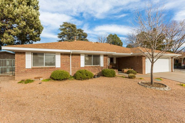 Updated home in a cul de sac on a large lot with easy care landscaping.  Updated price. New Refrigerated A/C recently installed! Updates galore in this ranch style brick home, highly desired open floorplan, big bedrooms & walk in closets. 2 yr old roof w/ warranty!  This home offers many possibilities, from the bar in the living area, the open space with room for a pool table to the cozy fireplace & built in bookshelves. Large  kitchen with newer stainless appliances & updated counter tops. Updated flooring. Wonderful oversized 2 car garage that will fit most any vehicle. Workshop in the back is equipped with electricity and provides a great space for projects. Home is nearby to the golf course, open space, parks, schools, shopping, & police station. This home has something for everybody.
