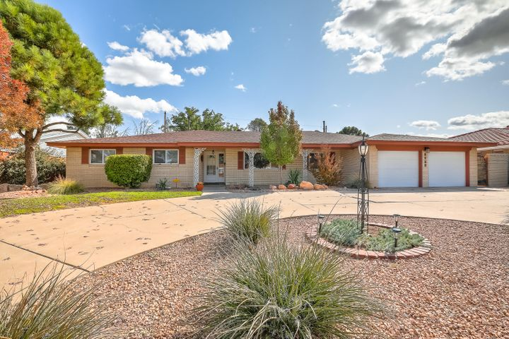 Remodeled, single story home in highly sought after UNM North neighborhood. Featuring a grand kitchen with custom cabinets, granite counters, stainless appliances, and so much storage! The wood floors, sky lights, newer roof, refrigerated a/c and central heat are just some of the updates that make this home inviting and easy to live in. The master suite is incredible with a huge walk in closet, dbl vanity, water closet, walk in shower, and jetted tub!  The remodeled bathrooms are well appointed with custom tile work, cabinets and granite. Sit back and relax as its fully landscaped with auto sprinklers/drip system, covered patio and gas stub out. Conveniently located giving you a community, neighborhood park and easy access to local restaurants, UNM, the Labs and Kirkland Air Force Base.