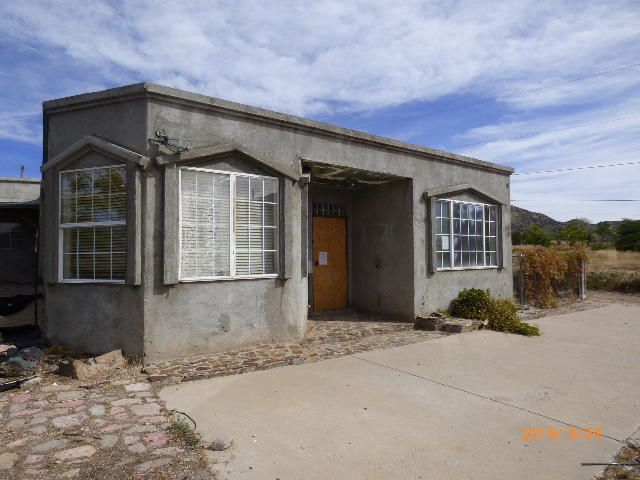Here is a great investment oppurtunity. The home is located in the popular Carnuel. Minutes from Albuquerque. The home features 3 bedrooms with a possiblity of 4 bedrooms. This home shows signs of the beginnings of a remodel, but it was not completed.