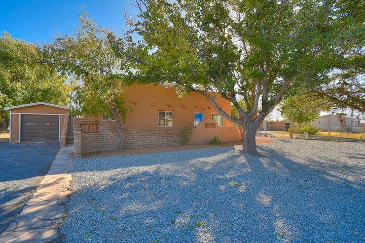 Don't miss this totally remodeled custom New Mexico style part-adobe home with soaring ceilings, exposed vigas, 1/3 acre on a cul de sac.  Backing onto open fields, this 2618 square foot, 4 bed, 2.5 bath home has a large vaulted master suite with private-view balcony, double vanity, soaker tub, walk-in shower and 3 closets. Spaciously designed kitchen hosts all new cabinetry with modern finishes, butcher block countertops, tile backsplash, and new stainless steel appliances. Open concept vaulted living/kitchen/dining opens to a private patio. Three adobe bedrooms with wood ceilings share a double vanity family bath with large walk-in closet. All new heating/cooling system and water heater.  Enjoy rural living Five minutes from I-25 and the Los Padillas Community Center.