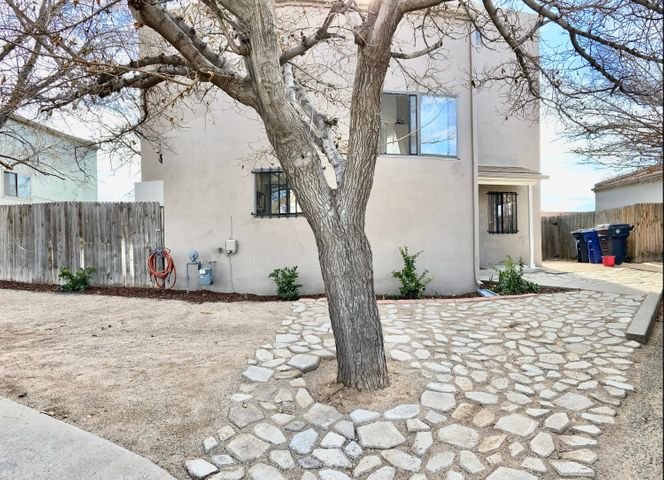 Great find close to UNM and CNM... Updates through out.  All new flooring and paint, Kitchen and bathroom remodeled added new half bath down stairs.   Large back yard and covered patio.