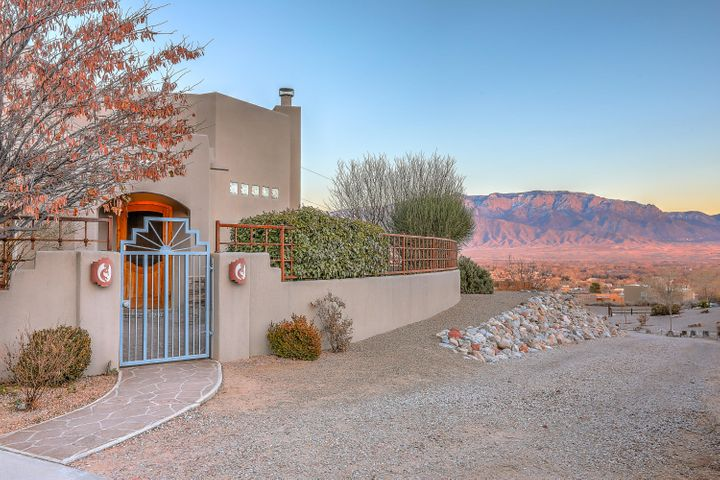 Truly Fabulous!  Just listed this desert jewel with privacy & incredible views!  Sits at end of paved road,  gated entry, & well maintained.  This 3 BR, 2 BA, 3 CAR,  home was crafted by Rachel Mathews.  Open, light and well designed for quality living.  Spacious GR boasts high ceilings, east exposure for views and kiva fireplace.  Formal dining,  a cooks kitchen w/island, updated appliances, plenty of counter space, & pantry.  Access to the east patio/courtyard with your outdoor kitchen,  fire place, outdoor fountain in a private landscaped oasis.  Two generous BR's, full BA &  service room.  MBR suite upstairs w/garden style bath, walk in closet, east balcony for more views and special moments. 3 Car garage w/dog friendly access. Immediate access to trails.  A great place to call home!