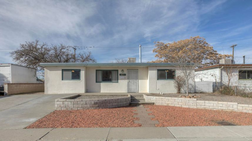 This home is very light and bright with some of the most amazing views of the mountains you'll find in  Albuquerque!  Only 2 other houses between you and Matheson Park! Large back yard with an over sized dog run and possibility for back yard access. Enjoy the fresh paint and carpet, as well as stainless steel appliances in the kitchen! Newer Roof (2015) Roof warranty is transferable. Newer (2016) furnace and  sewer line (2016)! Sewer line warranty is also transferable. Great lockacble 8 X10 steel storage shed also conveys. Convenient North East location! What are you waiting for? Let's make this house your home!