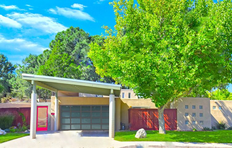 $5000 BUYER BONUS to easily reconvert the 2 CAR GARAGE or however you wish! This striking yet subtle contemporary design welcomes you to an almost private compoundnd-like setting with secure courtyard entry and outdoor living space that brings the outdoors into nearly every room of the house! Step inside and you will be WOWED by the modern & open concept living & entertaining spaces, walls of glass doors & windows, and soaring ceilings! Upgraded Kitchen has crisp white cabinets, granite counters, SS Appliances & bkfst bar! BIG Bedrooms & 3 Bathrooms (2 Masters) or use the $5k Bonus to easily reconvert the 4th bed. back to a 2 Car Garage (as it used to be) or flexible use space -- shown in photo renderings. Ref A/C, New Pitched Roof, Resurfaced Stucco, Outside Storage Room, Waterfall +++!!!