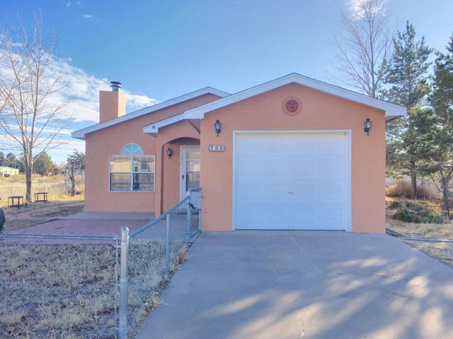 Welcome home to this wonderfully renovated 3 bedroom and 2 bath house close to town and airport with fresh paint and carpet throughout all living areas and bedrooms. Small community livng and only 35 minutes from the Big I in Albuquerque. The living room features a wood-burning fireplace for a warm, cozy place to relax.The updated kitchen has brand new stainless steel appliances including refrigerator, range/oven (5-burner gas), microwave and dishwasher as well as all newly installed vinyl flooring. Kitchen also has a spacious walk-in pantry. **Be sure to click the link for the 3-D Virtual Tour of this home** SCHEDULE YOUR SHOWING TODAY!!