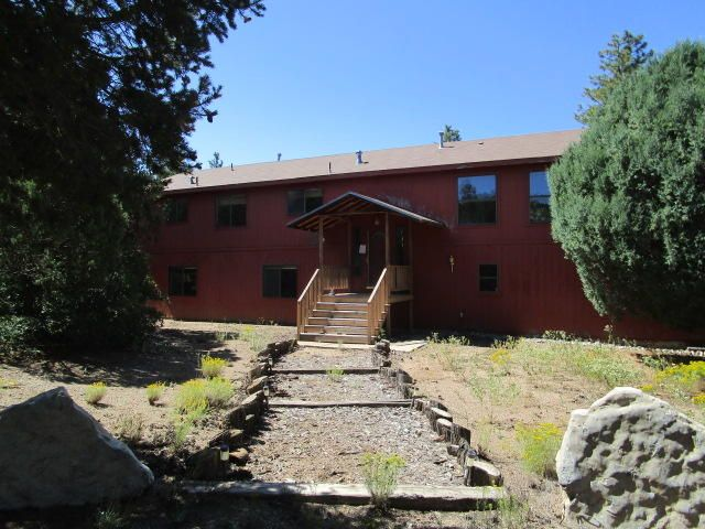 Mountain style living only ~20 minutes to the city.  Private lot with large pines.  Cabin style home, open & bright floor plan, two  living areas, fireplace plus a wood burning stove option, four bedrooms + an office, dining area + dining bar, large master bedroom w/ views, double sinks & separate garden tub and shower, view deck, cover porch entry, vaulted ceilings, large laundry service room, storage building & wood shed. Opportunity for Buyer to restore for equity. Certain information herein has been obtained from MLS history and/or tax records. Square feet and other information has been obtained from county tax records. All financed offers must include a lender pre-approval letter approving buyer for rehab financing. No pre-closing repairs will be approved.. Offer must include Seller A