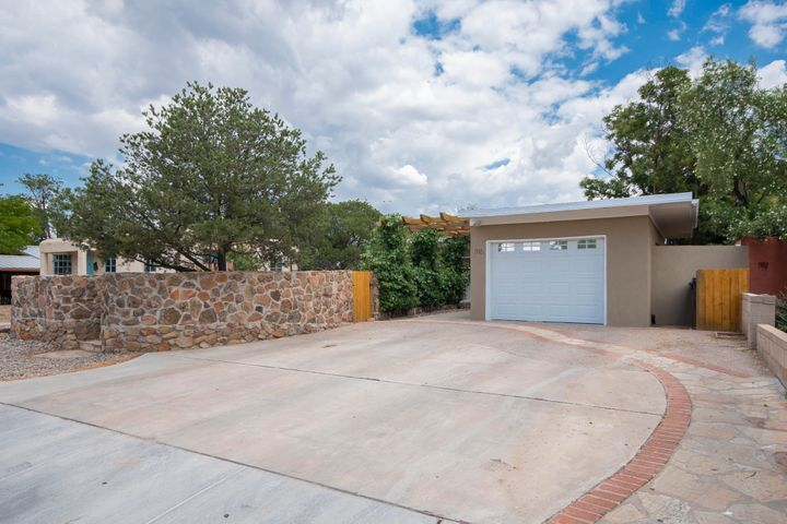Located across the street from UNM Law School and a short walk to the Medical Campus, this significantly updated home offers 2-3 living areas 4 bedrooms, 2 baths, and multiple outdoor living spaces. Plus an attached 1 bedroom, 1 bath casita. Recent roof, stucco, flooring, windows, plastered interior walls. Updated kitchen and baths. Location has made this unique property an excellent investment. Also Listed as income residential.