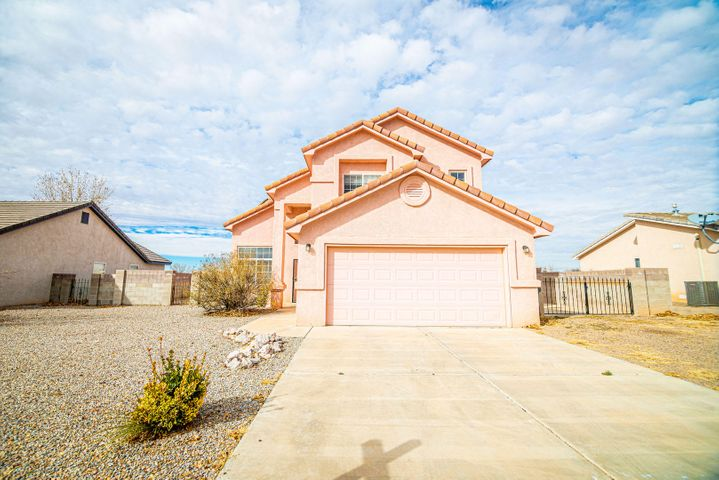 Two story beauty! This lovely home features vaulted ceilings with spacious floor plan which has almost 2000 square feet.  Roomy kitchen with island and breakfast bar is ideal for the family to gather around for the holidays.  Master bedroom is private and has a large walk-in closet and bathroom.  Nice views from the balcony, walled backyard with low maintenance landscaping and backyard access with concrete pad for parking recreational vehicles.
