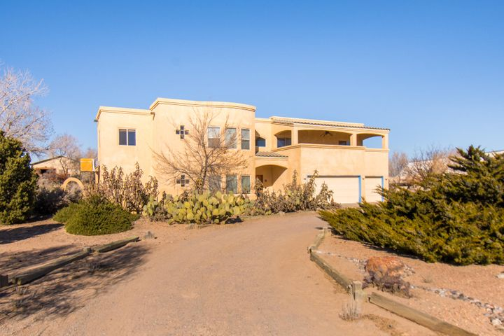 Two story home on cul de sac in far north part of Corrales, off of Loma Larga. Open floorplan on main floor with kitchen open to the den and formal dining room areas. 1/2 bath on first floor. Three car garage. Views of the Sandias. All bedrooms are on the second floor.