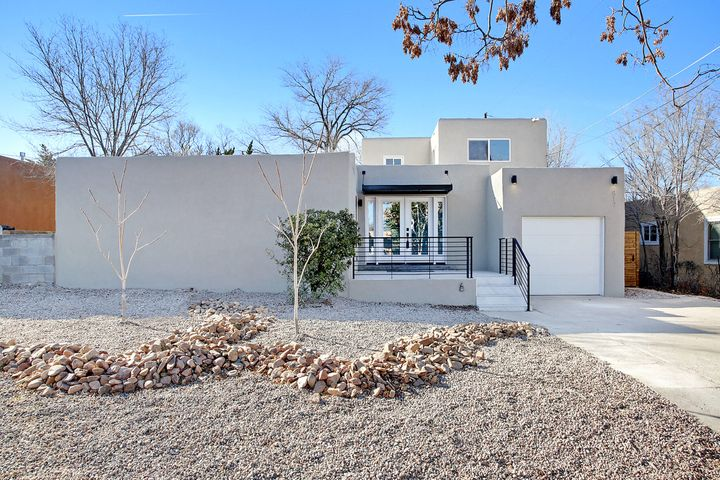 This Apex design property in UNM North is like a new home, & has been extensively updated into a contemporary show piece. An amazing light filled great room at the center of the floor plan, flows into the open kitchen with a corner fireplace, & eat at island. Quartz counters, new cabinets, stainless steel appliances, including a 5 burner stove, pantry & subway tile backslash from counter to ceiling. French oak wood floors throughout with large format tiles in the wet areas. Owner's suite on main level has a large walk in closet with a barn door. Luxurious bath with floating under lit double sinks, jet tub, separate shower & water closet. 2 bedrooms upstairs with  loft office space. Home boasts a new TPO roof, hot water heater, thermal windows, refrigerated air & heat. Backyard with pergola