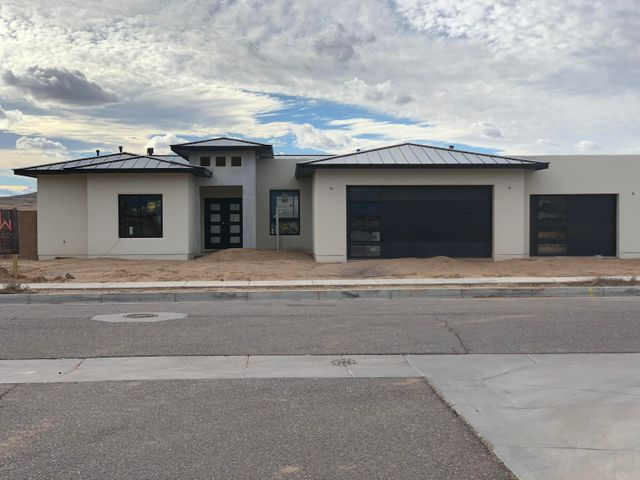 UNDER CONSTRUCTION - Stunning custom home in the highly desirable Petroglyph Estates. Home features 2,696sf w/ 4 bdrms, 3 full baths & 3 car garage (1 - 2 car deep that's also roughed in for 2 electric vehicle chargers). Open floor plan w/ spacious living area w/ gas fp. Backyard includes access for RV & natural gas extension for future outdoor kitchen. Chefs kitchen is perfect for entertaining w/ an oversized island & large walk-thru butler's pantry. Built in dbl oven & microwave drawer, refrigerator, dishwasher, cooktop & hood will be included. Beautiful master suite w/ his & her vanities & walk-in shower. Home also includes mudroom w/ office, (2) refrigerated air units, tankless water heater, custom cabinetry with soft close doors/drawers, granite countertops & Pella windows throughout.