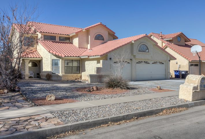 Huge home full of possibilities located in La Cueva school district and within walking distance to Rotary Park! Step inside this spacious 2-story to find an inviting foyer, high ceilings and architectural details throughout.  On the first floor is a sitting room, formal dining room, kitchen with breakfast nook and a family room with a gas fireplace, plus a bedroom and full bath.  Climb the spindle staircase to find 2 bedrooms with a jack-and-jill bath plus a deluxe master suite featuring plant ledges, double sinks, jetted tub and 2 balconies! Wow!Low-maintenance xeriscaping and small deck in the backyard are other features you will love.  Come take a look today!