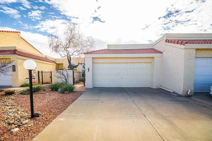Gorgeous updated home located in 'The Islands', an age 55 and over Gated Community in Rio Rancho! Enjoy the beautiful views from the back patio, living room and Master Bedroom! This 1801 SF 2 BR + office, has had many recent updates: Spring 2017-Kitchen remodel includes cabinets with self close feature,  granite counter tops, back splash tiles, range, microwave, dishwasher! New Floor tiles, carpet and paint (interior and exterior) throughout, new fixtures throughout! Custom Drapes June/2017.  New High Efficiency split heating and AC System 6/2018, also added was a GPS Indoor Air Quality unit which is attached to the blower. In April 2018 all windows and sliding glass door were replaced.  In May 2018, garage floor was epoxied!  Roof, windows, drapes &  HVAC all have transferable warranties!
