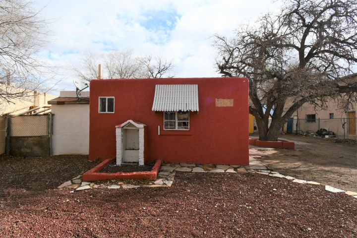 Front home is a 2 bedroom Property. It features a Utility room, step-saver Kitchen and Dining area, a good size Living Room 2 bedrooms and a 3/4 bath (shower only- no tub). The second structure on the property was originally used as a small studio apt. Currently it is not accessible for viewing, photos of the interior will be provided upon request. The property is zoned for multiple unit use.