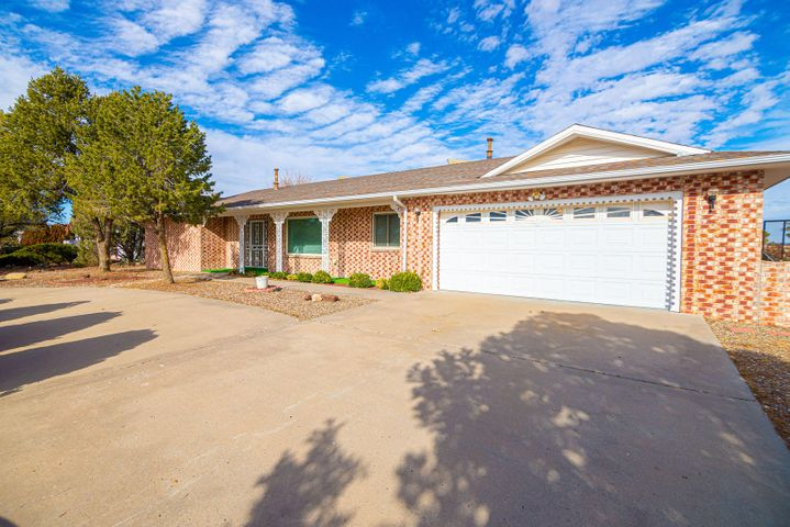 Well maintained home located on the 16th fairway of Tierra Del Sol Country Club.  Single story, all exterior brick for low maintenance, breathtaking view of the sunrise over the Manzano Mountains from the breakfast nook and 256 sq ft  finished sun room.  Screened-in porch next to open patio.  Third bedroom being used as a multi-purpose room with lots of storage.  All light fixtures are in the process of being upgraded!  Great neighborhood!
